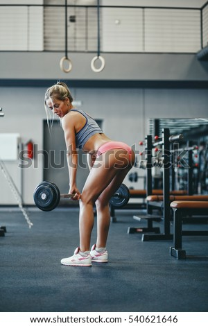 Sexy young athletics blonde girl doing deadlift with barbell. Fitness woman  in pink sport clothing workout with barbell in gym - Image eb586390b79c