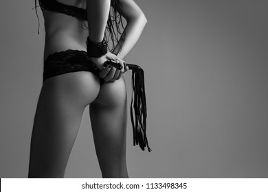 Sexy young beautiful dominant lady posing . black and white photo
