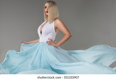 Sexy young beauty woman in fluttering dress. Beautiful Girl in blowing Dress Flying