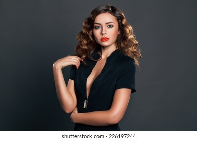 Sexy young brunette with curly hair. Beauty photo
