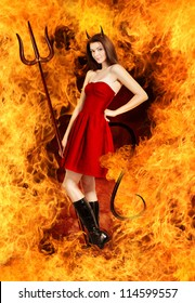 Sexy young brunette woman as devil in fire with horns, trident and tail