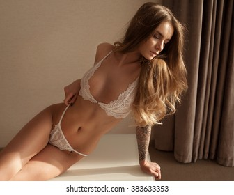 Sexy young brunette woman in lingerie