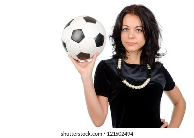 Sexy young brunette woman wearing a necklace of modern black and white beads holding up a matching black and white soccer ball