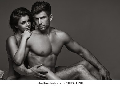 Sexy young couple in a bed
