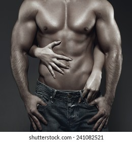 Sexy young couple body in dark, woman embrace man abs