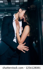 sexy young couple passionately kissing in elevator