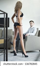Sexy young couple in room.