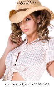 A sexy young  cowgirl with pigtails and a sexy smile