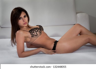 Sexy Young Female In Lingerie Lying On Bed