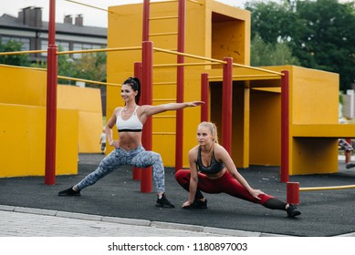 Sexy young girls go in for sports in nature. Healthy lifestyle, fitness.