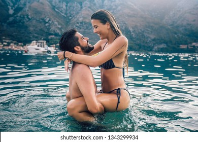 Sexy young loving couple on the beach having fun
