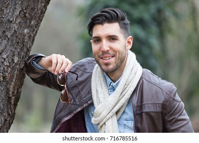 sexy young man posing in the nature