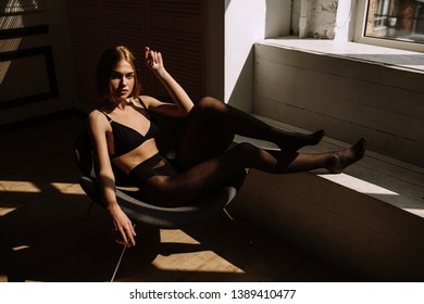 Sexy young woman with beautiful big breasts. The girl is represented in the studio. beautiful tanned skin, expressive eyes