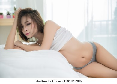 Sexy young woman in bedroom