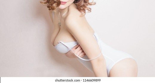 Sexy young woman with big breast. Beautiful body of woman.