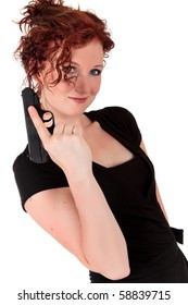 Sexy young woman in black dress holding a handgun. Studio shot. White background