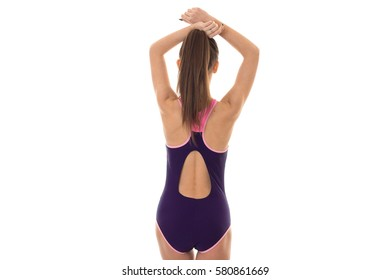sexy young woman in body swimsuit with sexy round buttocks posing from behind isolated on white background