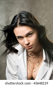 Sexy young woman with dark hair in a man's white shirt.