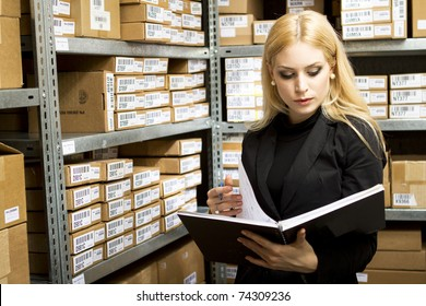 Sexy young woman doing inventory studio shot
