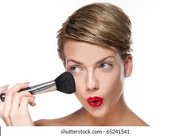 Sexy young woman doing makeup