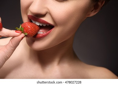Sexy young woman eating sweet food