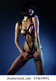 sexy young woman in erotic fetish wear dancing striptease in nightclub. Beautiful nude body of sensuality elegant lady. Nude sexy woman in black underwear. Sexy female fetish-wear. Erotic portrait
