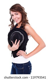 Sexy young woman holding black hat over white background