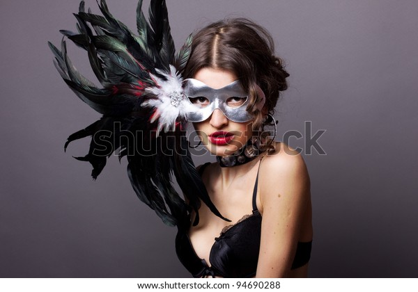 Sexy young woman in lingerie with mask