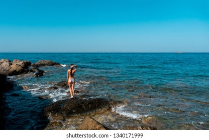 Sexy young woman in the ocean posing