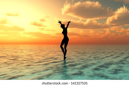 Sexy young woman on the beach at gorgeous sunset