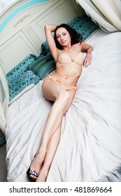 sexy young woman pose on bed