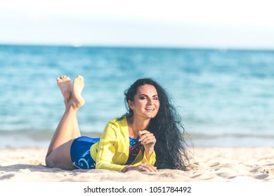 Sexy young woman posing on the tropical beach of Bali island, Indonesia. Asia.