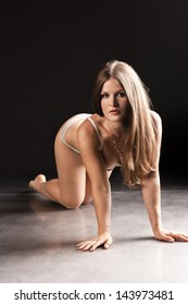 Sexy young woman posing on all fours