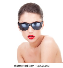 Sexy young woman with sunglasses looking at the camera, over white background
