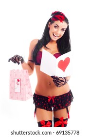 sexy young woman with a Valentine's card and a present in her hands