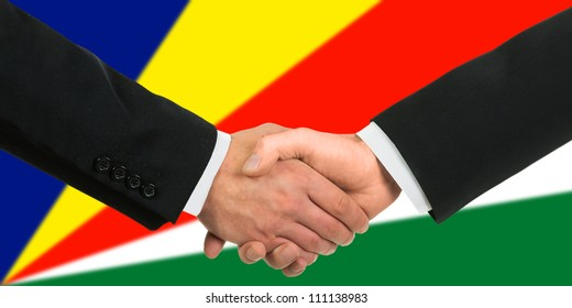 The Seychelles flag and business handshake