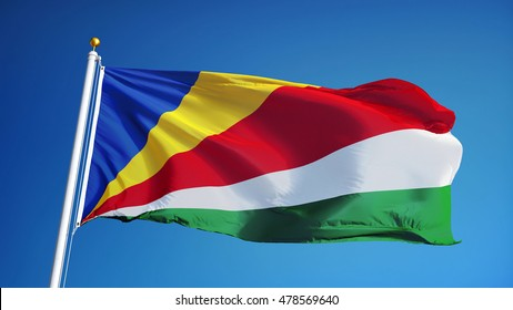 Seychelles flag waving against clean blue sky, close up, isolated with clipping path mask alpha channel transparency
