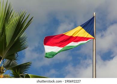 Seychelles waving flag on blue sky background