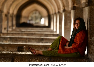 SFAHAN, IRAN - MARCH 26, 2018: unidentified people resting in the ancient Khaju Bridge, (Pol-e Khaju), in Isfahan, Iran