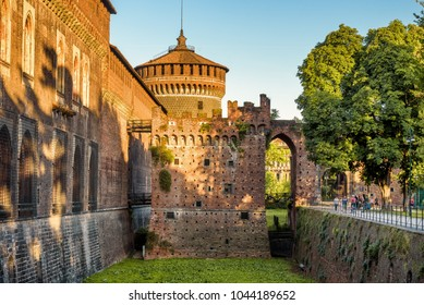 Sforza Castle (Castello Sforzesco) with moat in summer, Milan, Italy. This castle was built in 15th century by Francesco Sforza, Duke of Milan. Historical architecture and famous landmark in Milan.