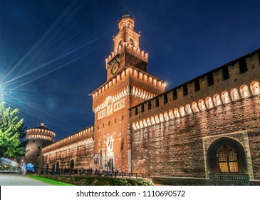 Sforza Castle (Castello Sforzesco) at night in Milano, Italy. The castle was built in the 15th century by Sforza, Duke of Milano. It is the main travel destination for tourist visiting Milano, Italy.