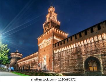Sforza Castle (Castello Sforzesco) at night in Milano, Italy. The castle was built in the 15th century by Sforza, Duke of Milano. It is the main travel destination for tourist visiting Milano, Italy.