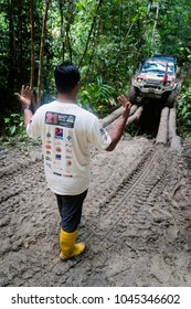 SG LEMBING, MALAYSIA - NOVEMBER 27, 2017: Rainforest Challenge Global Series Finals. Jungle mud roads, abandoned cars and extremely wet conditions on convoy track