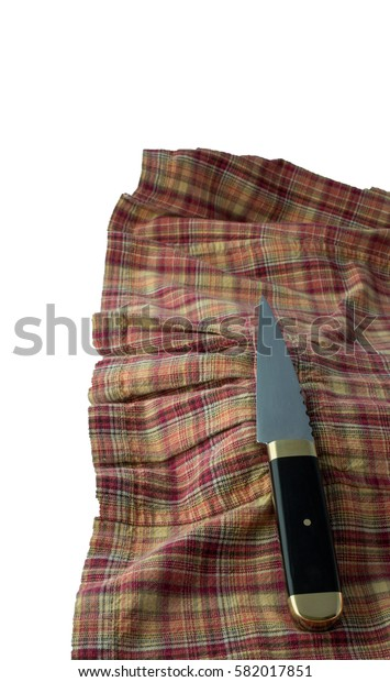 Sgian-dubh knife, more commonly referred to as a scottich knife, is a small single-edged knife often worn as part of traditional Scottish Highland dress along with the kilt.