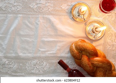 shabbat image. challah bread, shabbat wine and candles. Top view