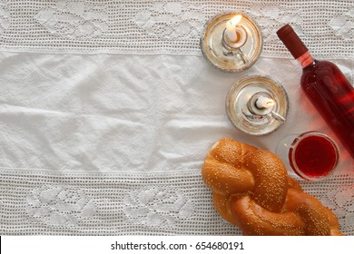 shabbat image. challah bread, wine and candles. Top view.