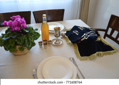 shabbat image. challah bread, shabbat wine and candles. shabbes table, top view
