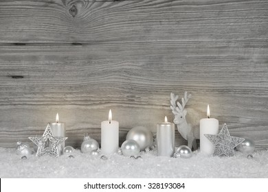 Shabby chic christmas background in grey, white and silver colors with for burning advent candles for decoration.