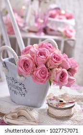 shabby chic style interior decoration with bunch of pink roses on the chair