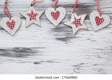 Shabby chic wooden shapes on vintage scratched background